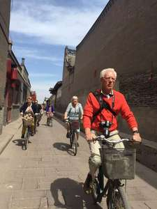 Riding in the pingyao alley